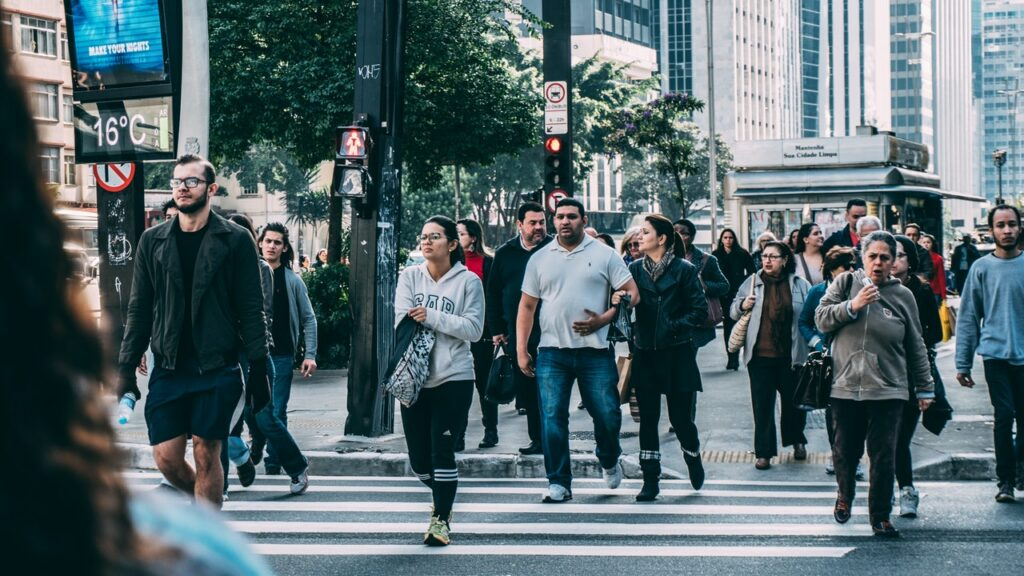 People from all walks of life walking together at an intersection
